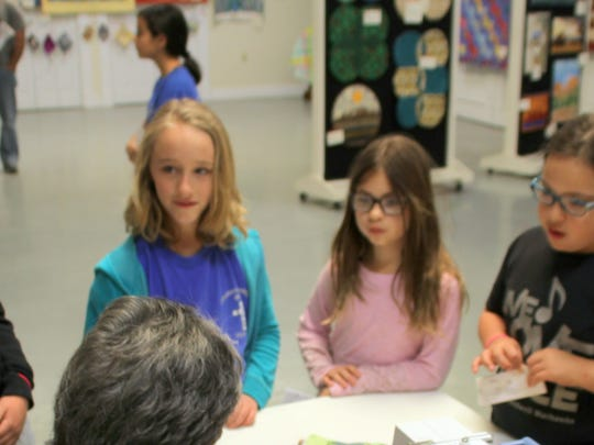Members of the American Heritage Girls, a Christian-based youth organization out of El Paso, listens to Nancy Costa explain the joy she gets from quilting. From left, are Sophia Conner, 10, Riley Cooper, 9, Aerin Lea, 8, and Olivia Lea, 9.
