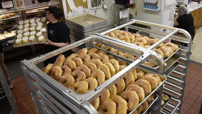 Freshly made doughnuts are ready for customers as part of National Donut Day  at Cold Spring Bakery.