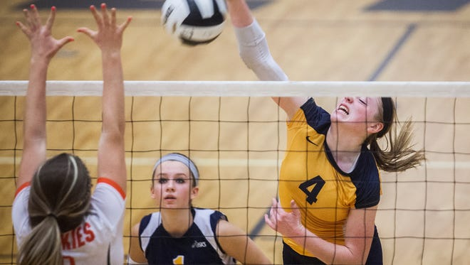 Delta's Chloe Stitt blocks a hit from Hamilton Heights during their sectional game at Delta High School Thursday, Oct. 22, 2015.