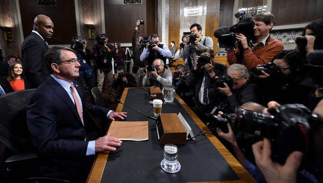 Ashton Carter,  President Barack Obama's choice to head the Defense Department, sits down on Capitol Hill in Washington, Wednesday, Feb. 4, 2015,  prior to testifying before the Senate Armed Services Committee hearing on his nomination to replace Chuck Hagel. Carter, who previously served as the No. 2 Pentagon official, is expected to easily win Senate confirmation but will face tough questions about Iraq and other issues.