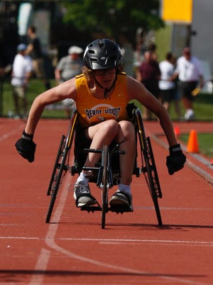 Berne Union's Abi George competes in the girls 100-yard dash seated race during the state track and field championships at Ohio State's Jesse Owens Memorial Stadium.