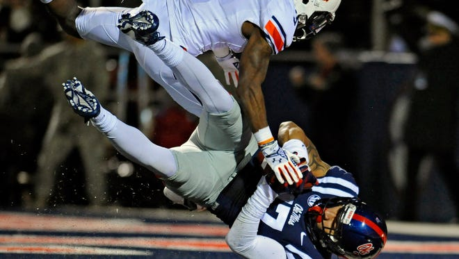 Tight end Evan Engram (17) scores a touchdown as Auburn Tigers defensive back Jonathan Jones (3) defends during the third quarter at Vaught-Hemingway Stadium. After returning for his senior season at Ole Miss, Engram should fill a vital role on the team's offense.
