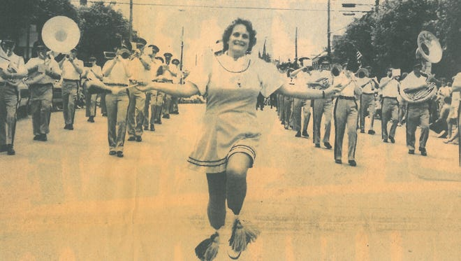 This old newspaper photo shows Bonnie Zinn as she leads the Shippensburg Band in a parade in 1988.
