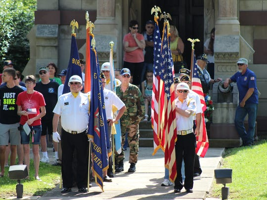 Marion County veterans prepare to post the colors during the Memorial Day ceremony Monday at Marion Cemetery.