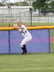 Brittany Ulmer fires a ball back into the Benton infield.