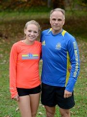 Seton Catholic cross country team members Jenna Barker,