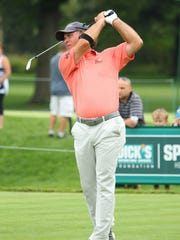 Scott McCarron follows through Saturday on his way to an 11-under-par 61 in the second round of the Dick's Sporting Goods Open at En-Joie Golf Club in Endicott. He shares the overall lead with Kevin Sutherland, at 12-under.