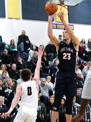 East Lansing's Brandon Johns, right, shoots over Grand Ledge's Sam Todd during the second quarter on Tuesday at Grand Ledge High School.