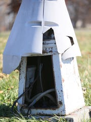 The plastic skirt, used to deter thieves, wrapped around a street light fixture is busted open exposing the empty case that used to hold a transformer coil seen in Chandler Park in Detroit on Wednesday, Nov. 13, 2013. Kimberly P. Mitchell/Detroit Free Press