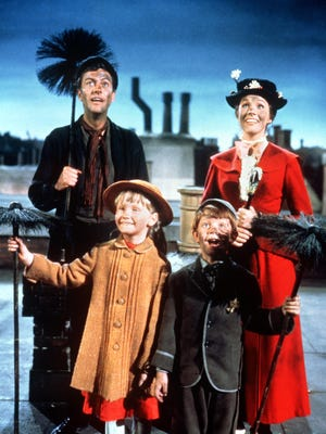Bert (Dick Van Dyke), Mary Poppins (Julie Andrews), Jane (Karen Dotrice) and Michael (Matthew Garber) sing in 1964's 'Mary Poppins.'