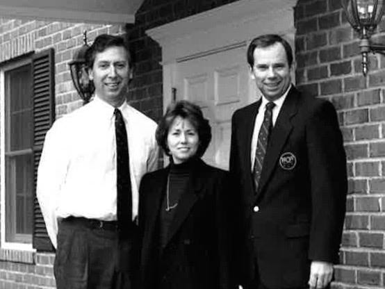 MGA executive director Jay Mottola (left), communications director Jeanne McCooey and former championship director Gene Westmoreland stand outside Golf House in 1994.