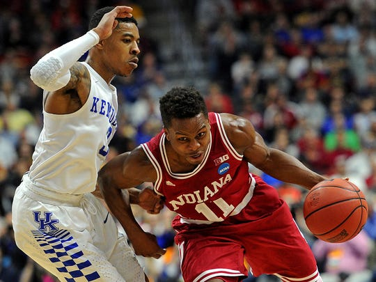 Indiana guard Yogi Ferrell (11) drives to the basket against Kentucky guard Tyler Ulis (3) during the second round of the 2016 NCAA Tournament at Wells Fargo Arena.