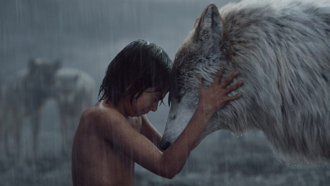 """Mowgli (Neel Sethi) shares a moment with his wolf mom Raksha (voiced by Lupita Nyong'o) in """"The Jungle Book."""""""