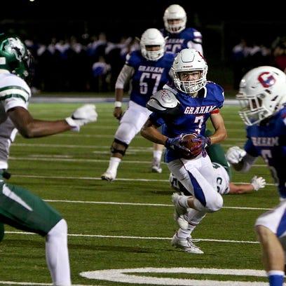Graham's Cameron Walker (3) rushes behind teammate
