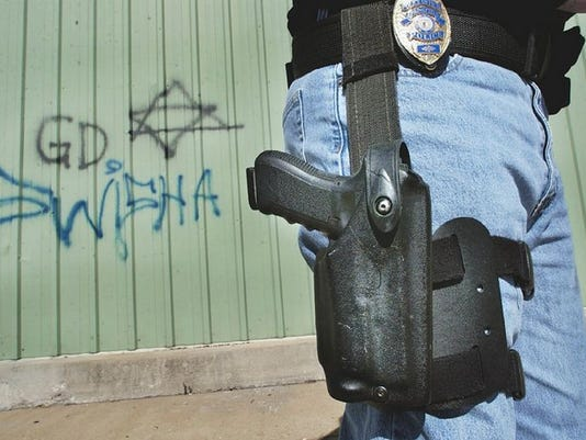 Graffiti near the Grant Avenue Viaduct includes a six-pointed star, a symbol associated with the Gangster Disciples. Police don't know