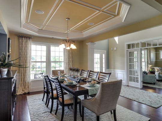 Standard features in Pulte's Whetstone houses include 9-foot, smooth-finish ceilings, Mannington hardwood floors and extensive trim and molding.