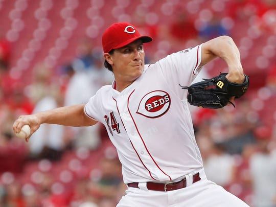 Cincinnati Reds starting pitcher Homer Bailey throws against the St. Louis Cardinals during the first inning at Great American Ball Park.