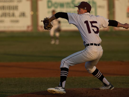 Sinton's Mason Hopkins throws a pitch during the first