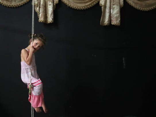 Avery Therrien, 4, swings on a trapeze at The Creative