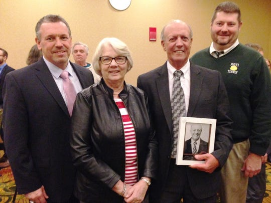 The Michigan High School Tennis Coaches Association inducted Jim Hanson (third from left) into its Hall of Fame. On hand for the ceremony (from left) is Novi A.D. Brian Gordon, JV coach Chris Hayward and varsity assists Dan Lowes.