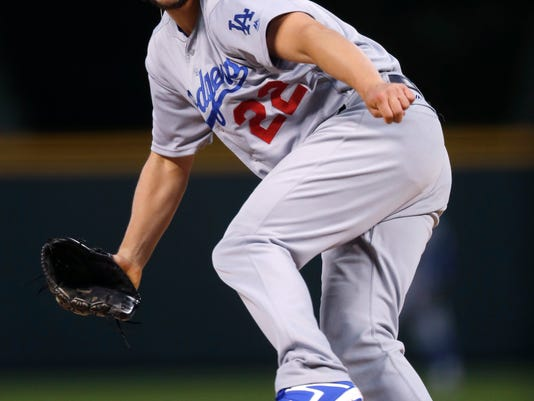 Los Angeles Dodgers starting pitcher Clayton Kershaw delivers a pitch to Colorado Rockies' DJ LeMahieu in the first inning of a baseball game Saturday, Sept. 30, 2017, in Denver. (AP Photo/David Zalubowski)