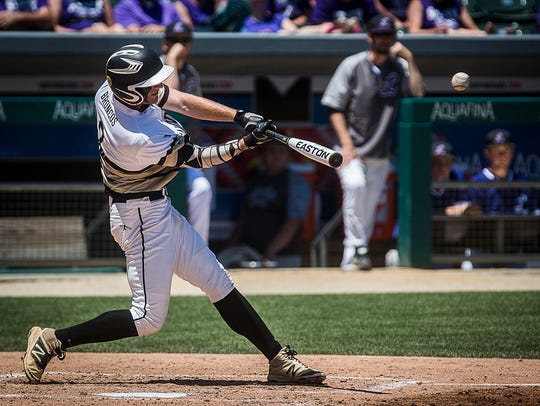 Daleville's TJ Price hits a home run against Lanesville