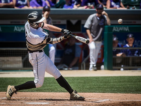 Daleville's TJ Price hits a home run against Lanesville during their state championship game at Victory Field last season. A good showing in the Delaware County Tournament could reinforce Daleville's danger to the rest of Class A.