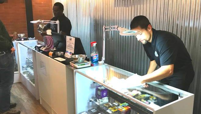 Employees at Cannabis 530 in Shasta Lake prepared Sunday for the new year when commercial sales of recreational marijuana becomes legal in California.