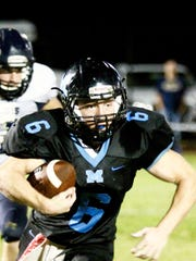 Austin Gross motors for a chunk of his 56 yards rushing