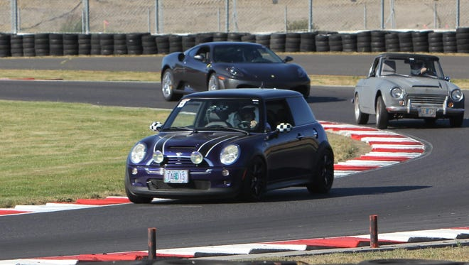 Drivers come through turn 12 at Portland International Raceway on Friday during the SCCA's Track Night in America.