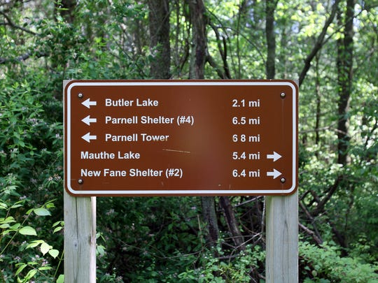 A sign at the Ice Age Trail junction for access to Shelter #3 in the Kettle Moraine State Forest denotes distances to various points of interest in the forest.