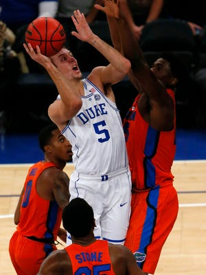 Duke Blue Devils guard Luke Kennard (5) goes to the basket against Florida Gators center John Egbunu (15) during the first half at Madison Square Garden.