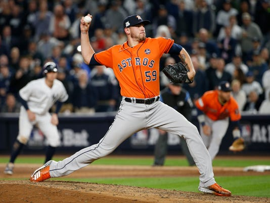 Houston Astros relief pitcher Joe Musgrove throws during the seventh inning of Game 4 of baseball's American League Championship Series against the New York Yankees Tuesday, Oct. 17, 2017, in New York. (AP Photo/Kathy Willens)