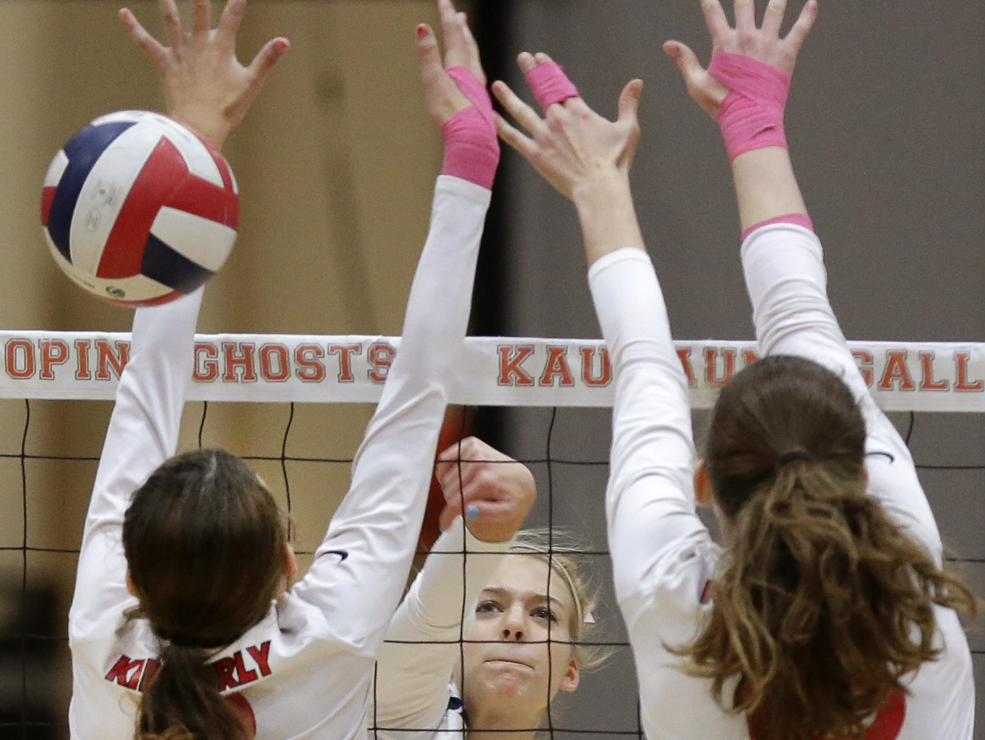 Appleton North's Cami Phillips (center) spikes through the defense of Kimberly during Thursday's match in Kaukauna.