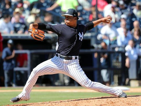 Yankees relief pitcher Justus Sheffield throws a pitch