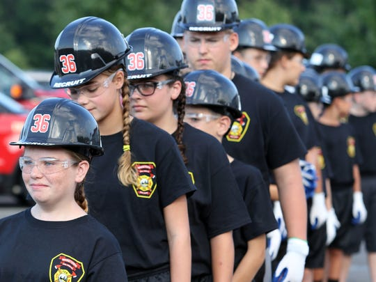 Junior cadets at the Ocean County Fire Academy in Waretown line up ahead of a controlled burn set by the real firefighters.