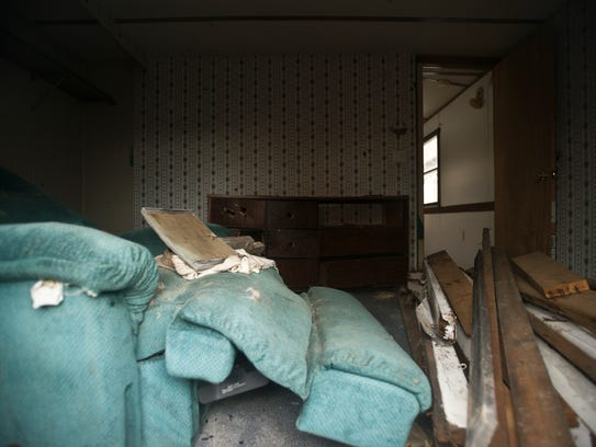 The inside of one of several abandoned mobile homes