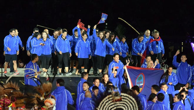 Team Guam on center stage at the 2015 Pacific Games opening ceremony.  The event was filled with the sights and sounds of all the 22 provinces of Papua New Guinea. Athletes from nations of the Pacific region were showcased at the ceremonies held Saturday, July 4 at the Sir John Guise stadium in Port Moresby, PNG.