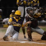 Hattiesburg pitcher Joe Gray sends a pitch to home plate during the Tigers' game against Long Beach in Hattiesburg on Friday night.