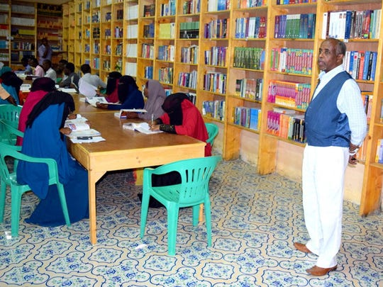 Dr. Yassin Dean of Mogadishu University Health Science Department is shown with a group of students.