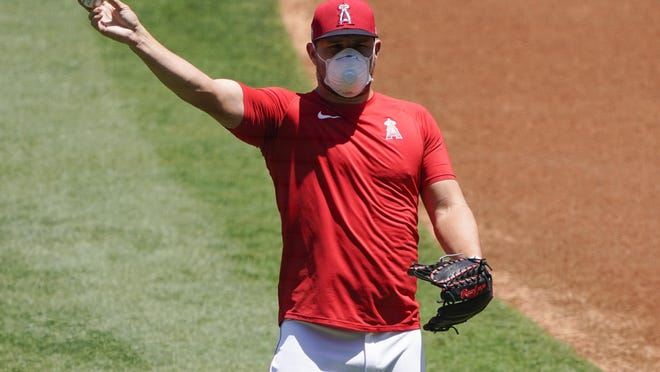 Los Angeles Angels center fielder Mike Trout throws a ball during baseball practice at Angel Stadium on Tuesday, July 7, 2020, in Anaheim, Calif.