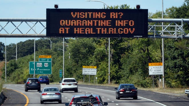 A sign with a quarantine message at the Rhode Island / Massachusetts border on Route 195 West.