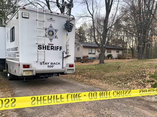 FILE - In this Oct. 23, 2018, file photo, a Barron County, Wis., sheriff's vehicle is parked outside the home where James Closs and Denise Closs were found fatally shot on Oct. 15. The Barron County Sheriff's Department said on its Facebook page that the missing teenager Jayme Closs has been found alive Thursday, Jan. 10, 2019, and that a suspect was taken into custody. (AP Photo/Jeff Baenen, File)