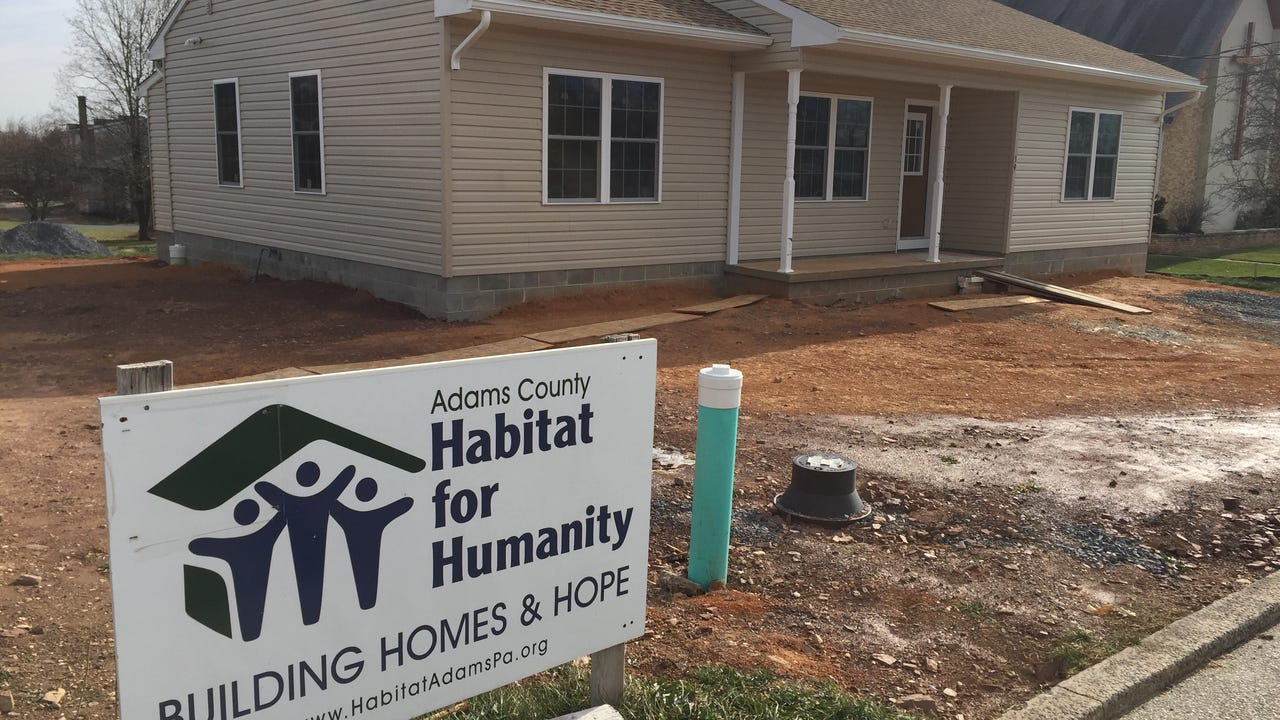 Volunteers from Habitat for Humanity and Hollabaugh Bros. Fruit Farm and Market gathered on Saturday to help prepare the future home of two of the company's employees.