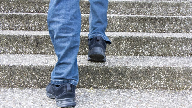 Man climbs on a concrete stairs
