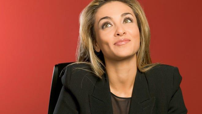 Businesswoman in black suit.