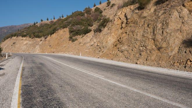 Asphalt roadway along the mountains.