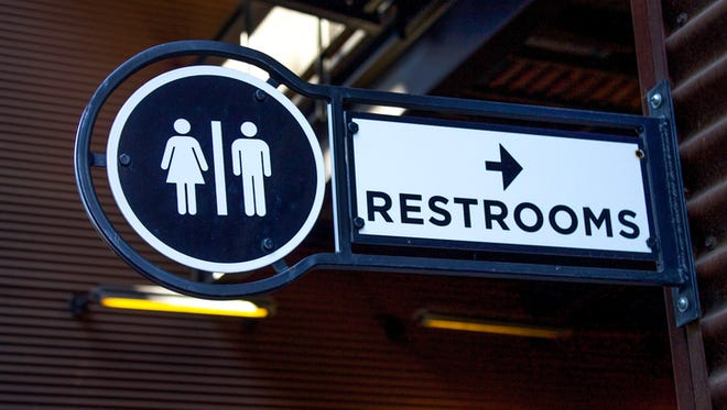 Stock photo of a restroom sign.