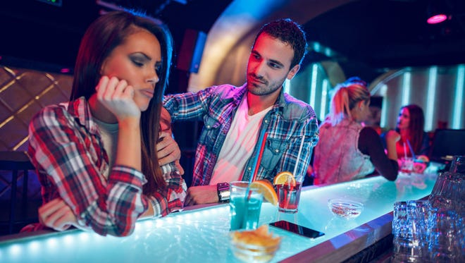 Young couple is in the nightclub