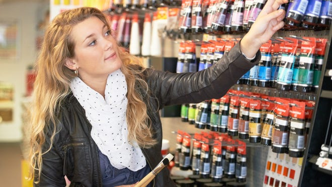 Shot of a young female artist shopping for acrylic paint in an art store for supplieshttp://195.154.178.81/DATA/istock_collage/0/shoots/781464.jpg